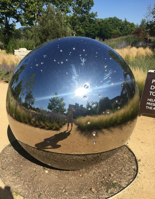 Silver reflecting orb.